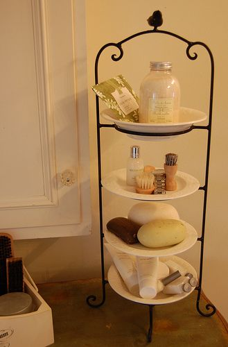 use a plate stand to create extra space on the bathroom counter: Create Extra, Guest Bathroom, Small Bathroom, Bathroom Storage, Bathroom Ideas, Clever Ideas, Extra Spaces, Bathroom Counter, Plates Stands