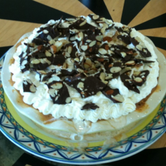 Pumpkin ice cream pie with whipped cream and dark chocolate almond ...