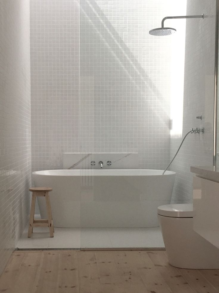 Main Bathroom, Gloss white 30x30 tiles, Matt White 600 x 600 tiles, Baltic Pine Floor, Calcutta Marble Benchtop Minimal white bathroom