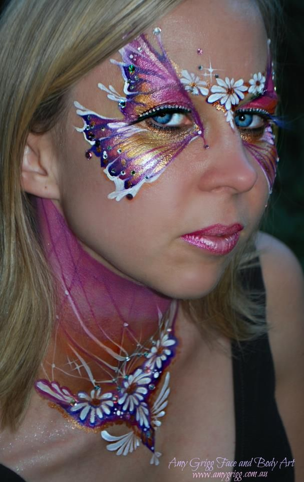 Metallic look butterfly inspired masquerade make-up mask with crystal accents, rhinestone eye lashes and artistic daisies by MUA Amy Grigg.