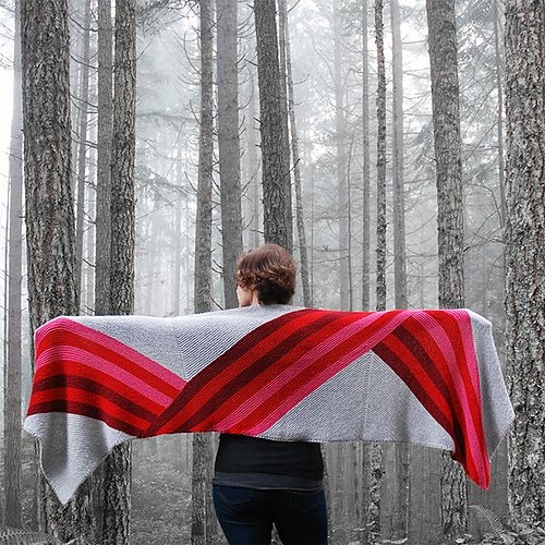 Featuring a bold gradient stripe that appears to fold over on itself, this large, cozy wrap is the perfect thing to throw on when you want both comfort and style.