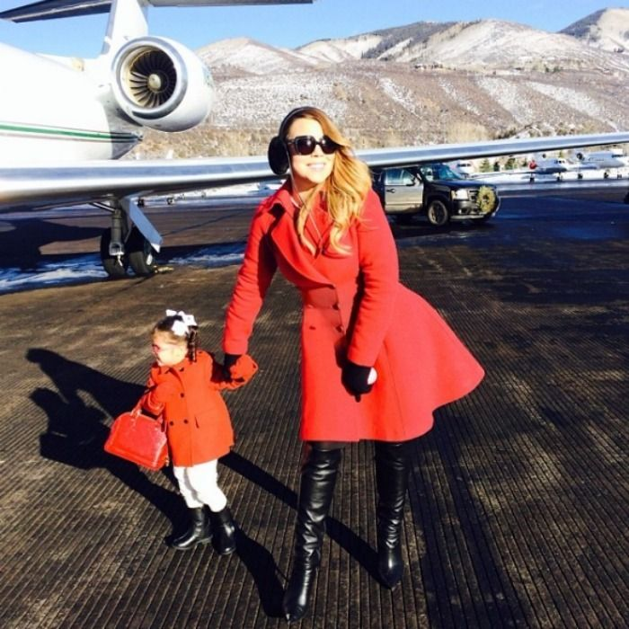 Diva in the making five-year-old Monroe Cannon dresses in a red coat to match mother Mariah Carey's