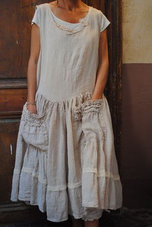 I like the roughness of this one, and the wonderful skirt with pockets.  Something about a pinafore makes me want to paint.