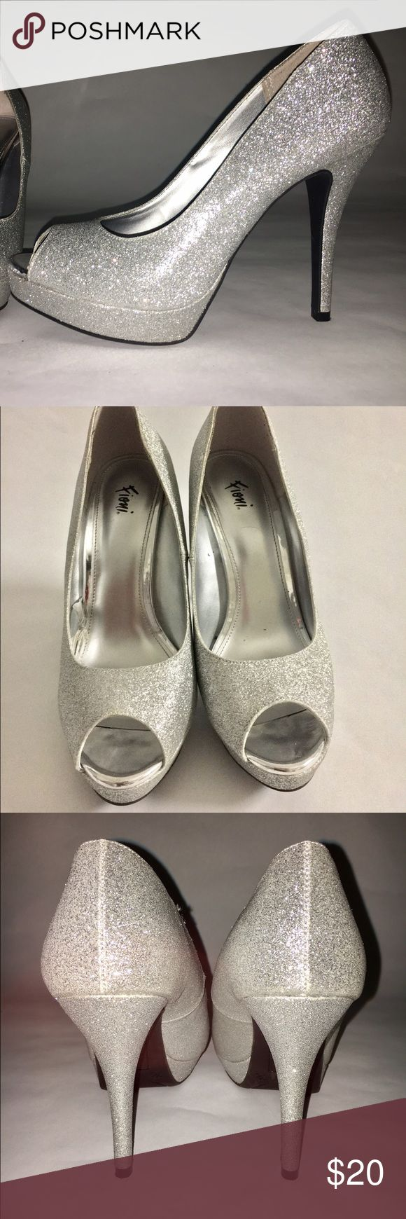 Silver Peep Toe Heels Worn once for a wedding. Gently used. Great shoes for a wedding or festive occasion like New Year's Eve party or a prom. Shoes Heels
