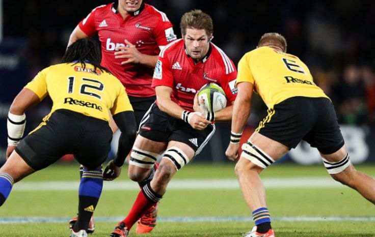 Crusaders 35 vs 18 Hurricanes Richie McCaw of the Crusaders runs at Ma'a Nonu (L) and Brad Shields of the Hurricanes during the round 16 Super Rugby match between the Crusaders and the Hurricanes at Trafalgar Park on May 29, 2015 in Nelson, New Zealand…