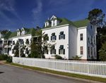 The Roanoke Island Inn is a picturesque refuge in the small coastal town of Manteo. More than a century old, this house was built in 1860s by Asa Jones and his wife, Martha. Now owned by John Wilson -- great-great-grandson of Asa Jones -- the Ro