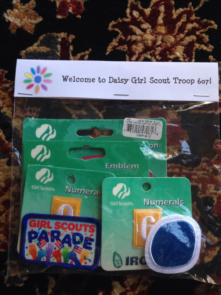 Packaged Daisy uniform insignia and badges to hand out at the first meeting. Just a ziplock bag and printed strips folded over and stapled. Quick and cute!