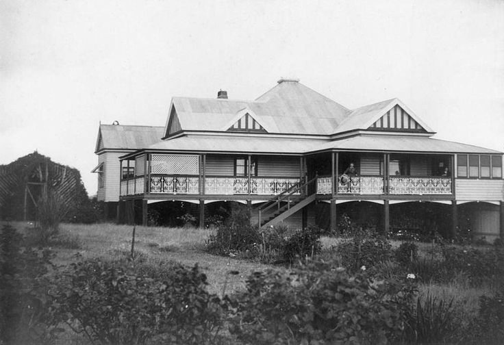 Toowoomba residence, Enville, Toowoomba, Queensland, ca. 1914 - Expansive Queenslander house with corrugated iron roofs and semi enclosed side veranadahs. Possibly a member of the MacIntyre family on right hand side of the photograph.