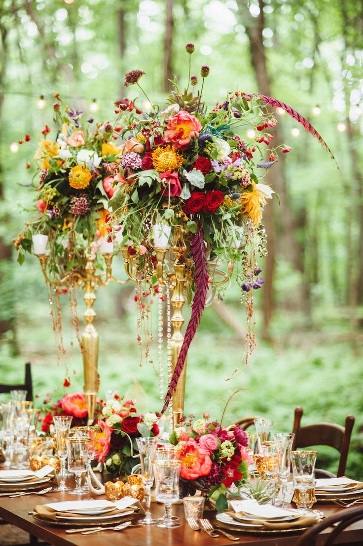 Candelabra were topped with floral arrangements that reflected the natural wilderness of the setting. #receptiondecor Photography: Veronica Varos Photography. Read More: http://www.insideweddings.com/weddings/a-bohemian-inspired-wedding-shoot-in-an-enchanted-forest/643/