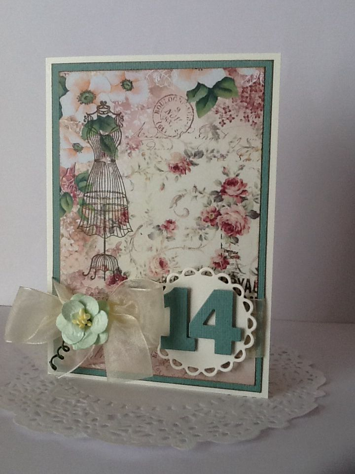 Green base and designer floral paper on ivory card. Spellbinders lacey circle die with die cut numbers. Includes ivory tulle ribbon with a dainty green flower. Perfect for a teenage girl.