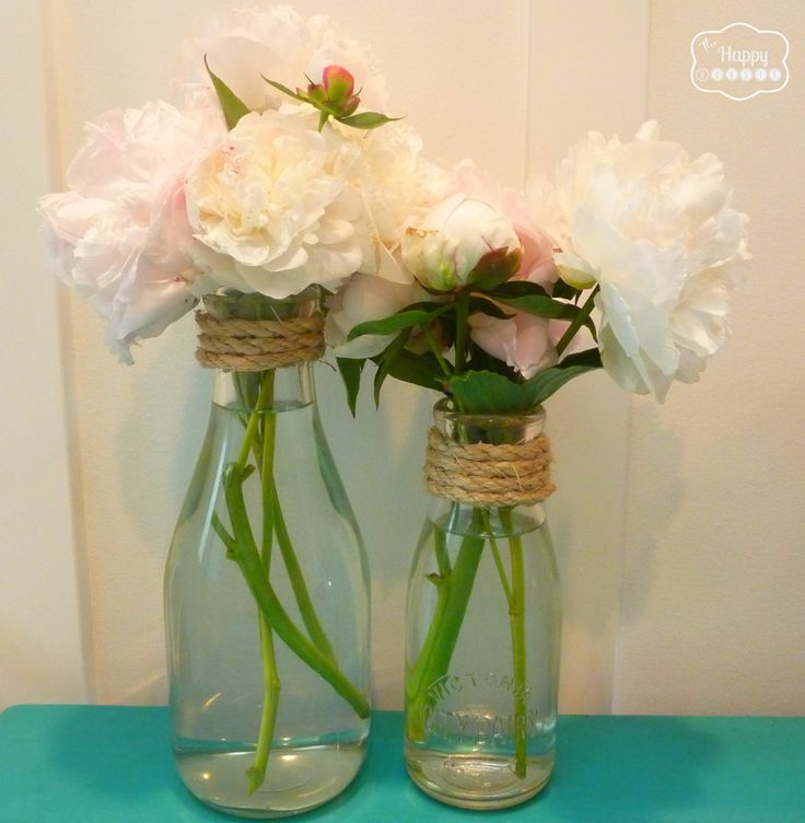 simple sisal rope embellishement on vintage milk bottles at thehappyhousie