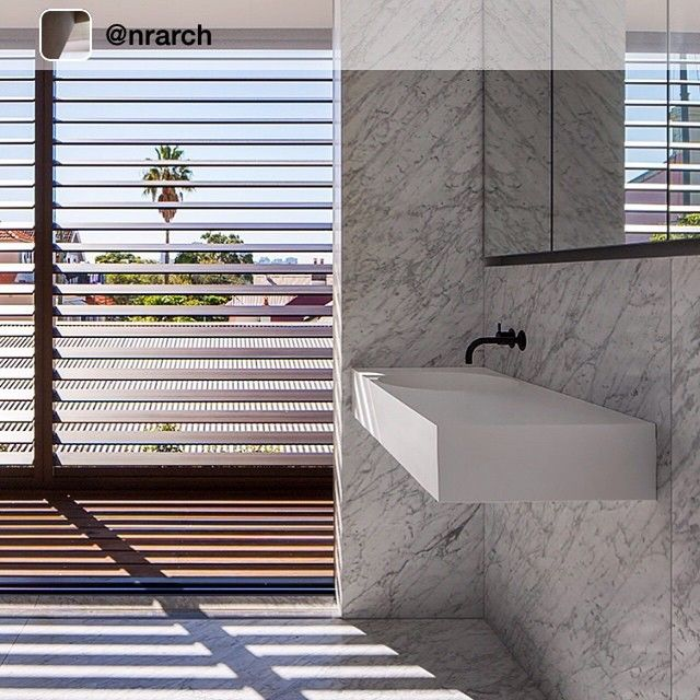 Stunning bathroom with exquisite marble walls and floor. The sophisticated yet uncomplicated Omvivo Neo wall basin works perfectly.