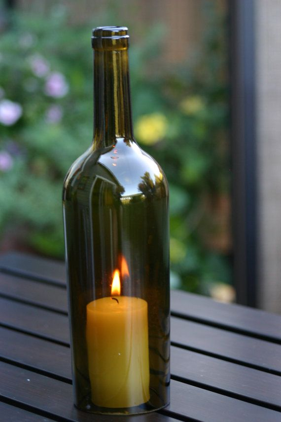 17 best images about wine bottle candle holder on for Champagne bottle candle holders