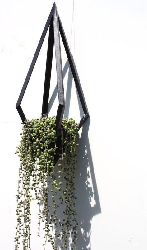Urban and contemporary black steel diamond shaped hanging basket/planter, hand-made by artist Daniela Rubino.50 x 20 cmPlease allow 2-3 weeks max for delivery of this item.