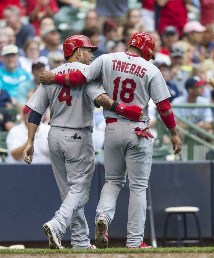 Yadier Molina and Oscar Taveras walk off the field arm in arm after they both scored against the Milwaukee Brewers. Cards won 9-1. 9-07-14 R.I.P. TAVERAS!! 10/26/2014--Cardinal Nation Will definitely MISS YOU!!!  :'(  :'(  :'(
