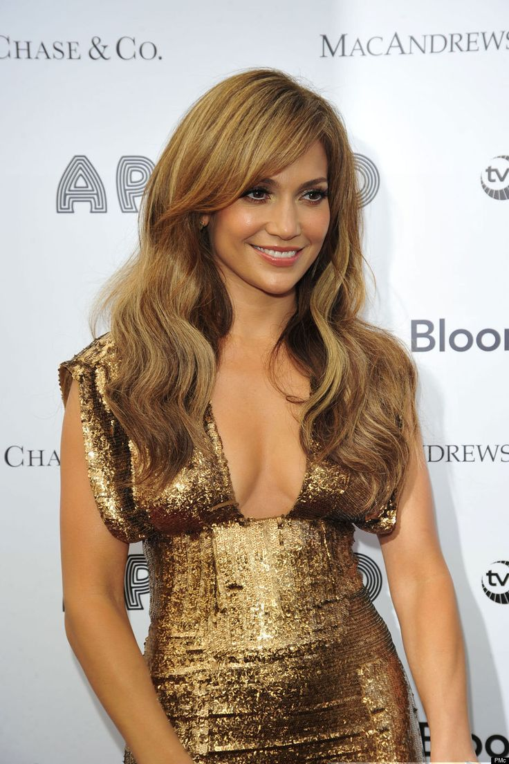 Jlo is playing santa blonde highlights hair color