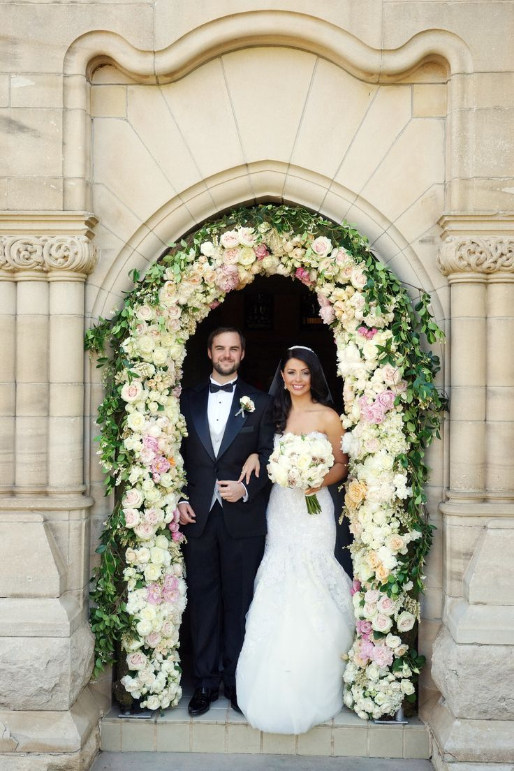 My beautiful husband and I under the floral archway at The King's School Chapel.