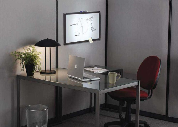 Simple Office Chair And Table with small white board and table lamp