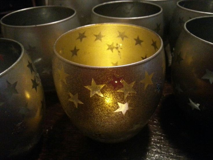 Jazzed up some cheap tumblers with stickers and spray paint. Peeled the stickers off, added a layer of spray laquer then glued on sequins to hide any imperfections. Added a tea light and voila a low cost present to give :)