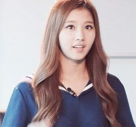 This is a gif of Sana from the Kpop girl band TWICE.