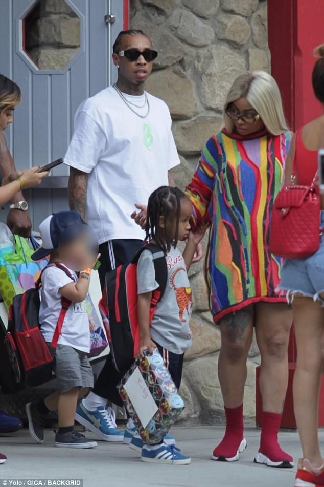 Day out: Exes Blac Chyna and Tyga have kept their rapport amicable enough to take their son King Cairo Stevenson to Six Flags Magic Mountain in Los Angeles together