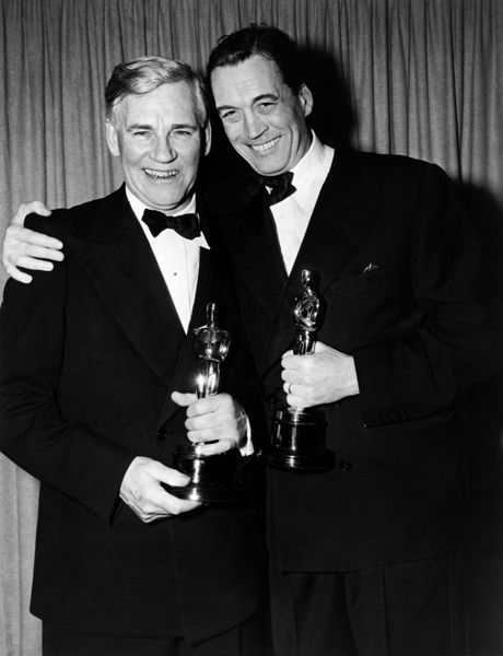 """During the 21st Academy Awards presented on March 24, 1949, Walter and John Huston became the first father/son duo to win academy awards. Walter Huston won the best supporting actor award while his son, John Huston, received an Oscar for directing. They both won for their work in """"The Treasure of Sierra Madre."""""""