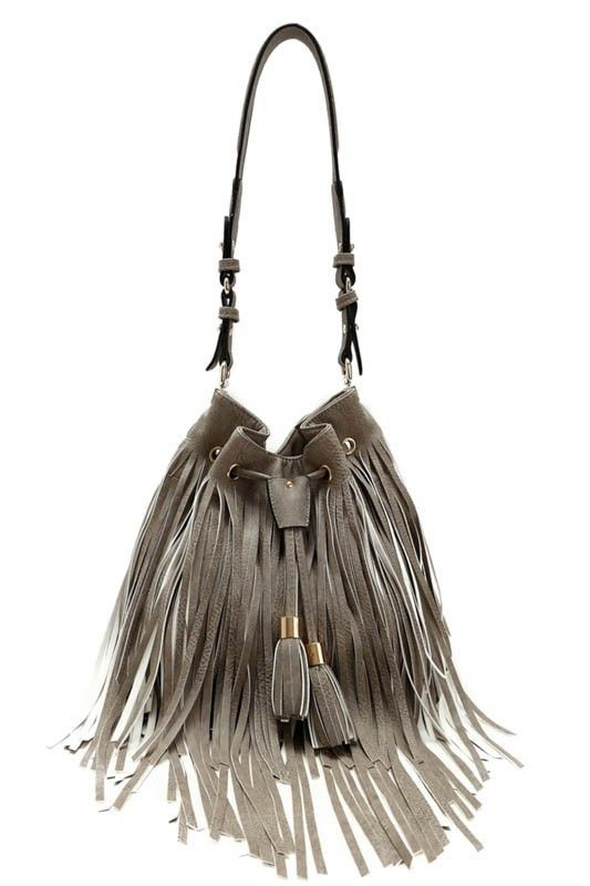 Stardust BagLoving the chic look of this bag and the on-trend fringe. A long fringe and draw string bucket bag accented with a long crossbody strap. Two compartments and two zippered pockets, finished with a drawstring snap closure. Fully lined.
