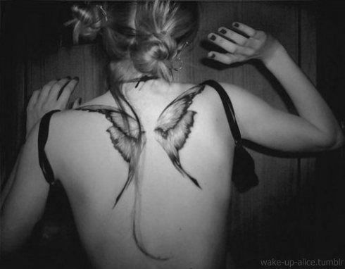 I don't usually care for butterfly tattoos, but wow, this is quite striking.