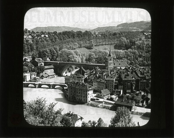 The river Aare at Berne and distant Alps, Switzerland   saskhistoryonline.ca