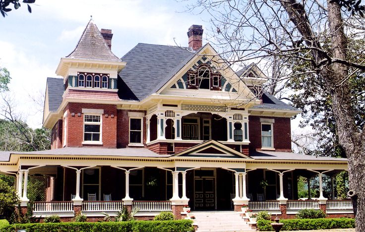One of my dream homes. I love victorian style homes. Old fashioned with big porches. I would have to have a porch swing though. :o)