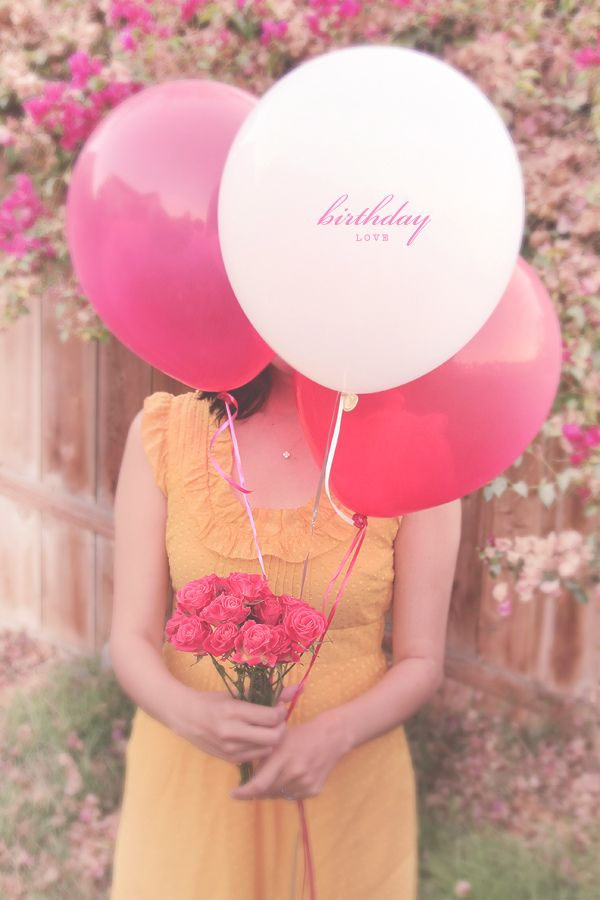 Love how her face is hidden behind balloons.