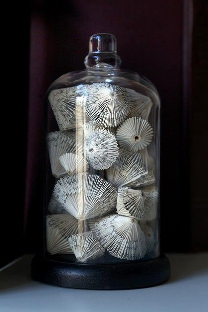 Repurposed books. The delicate folding makes them look like little tops, ready to be spun.