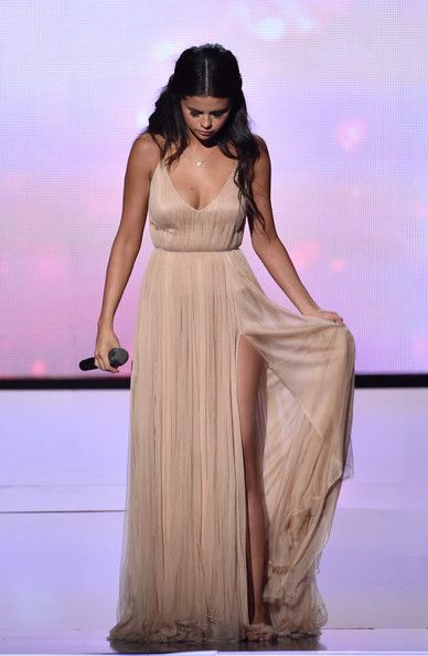 """Selena Gomez performs """"The Heart Wants What It Wants""""at the American Music Awards 2014."""