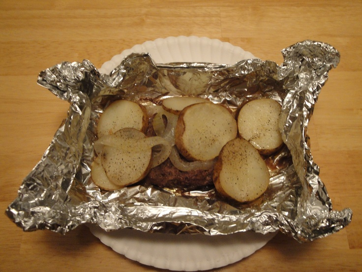 Hobo Dinner: Cook over fire, serve in tin foil (I would add more colorful veggies and some beef stewinge meat)