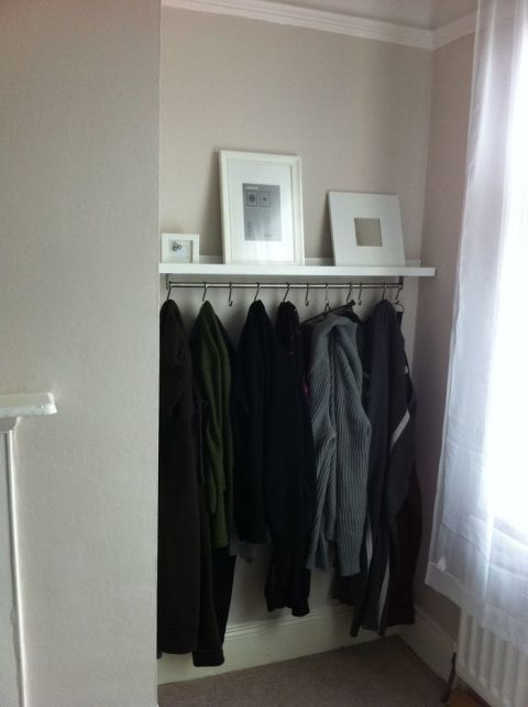 Did you know your IKEA RIBBA picture ledge is the perfect place to hang your outerwear? When hooks are attached underneath this rail it becomes a multipurpose piece of furniture in your bedroom or entryway: You can organize your jackets on the bottom and showcase artwork on top. Click through for more on this and other IKEA RIBBA picture ledge hacks.