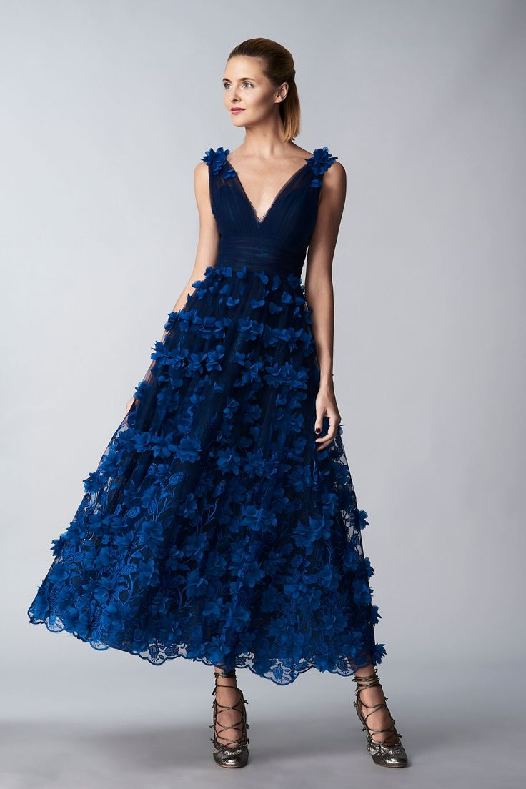 Make a statement at your winter wedding with this unique floral bridesmaid look. Shop it now on FarFetch.com!