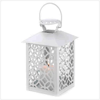 "Reminiscent of the glasswork found in the finest Spanish estates, the panels of this candle lantern delight the eye with radiant patterns of light. The very essence of timeless design!    Weight 1.5 lbs  Construction: Iron and glass  Candle not included.  Dimensions:  4 3/4"" square x 7 1/2"" high; 9 3/4"" high with handle."