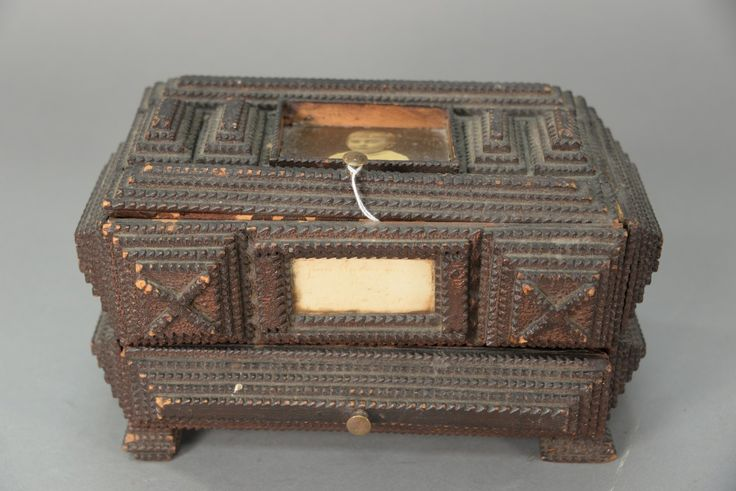 Chippendale carved tramp art jewelry box with lift top box over one drawer on four feet.