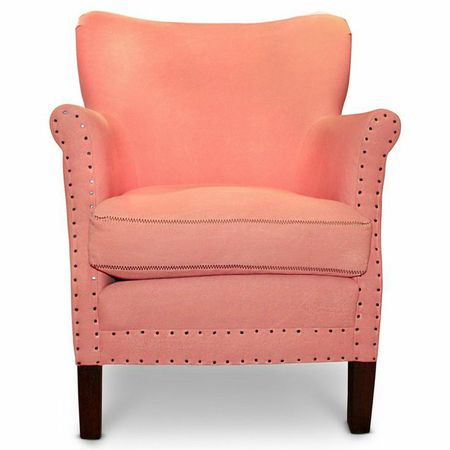 coral armchair with nailhead detail