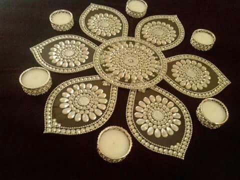 Kundan rangoli in white. Looks even more beautiful!