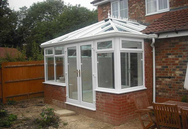 Academy Conservatory in White uPVC with ActivBlue Glass Roof.