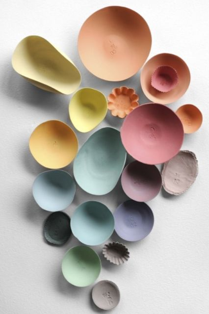 my colored pastel porcelains in print in elle france ,ceramics dietlind wolf photo : nathalie carnet, production: sergio da silva, assistance : marie