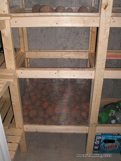 Potatoes bins in cold storage room. DIY a cheap cold storage room in your basement: http://www.usa-gardening.com/cold-storage/cold-storage-room.html