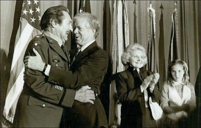 "Matt Urban receiving the Medal of Honor in 1979, or as he was more appropriately known: ""The Ghost."" By the time World War 2 ended, the Ghost would be awarded the Medal of Honor along with seven purple hearts, two Silver Stars, three Bronze Stars with a V, and a number of other honors making him one of the most highly decorated soldiers of the war."