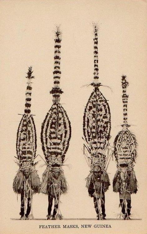 Feather masks, New Guinea. Postcard, Australia.