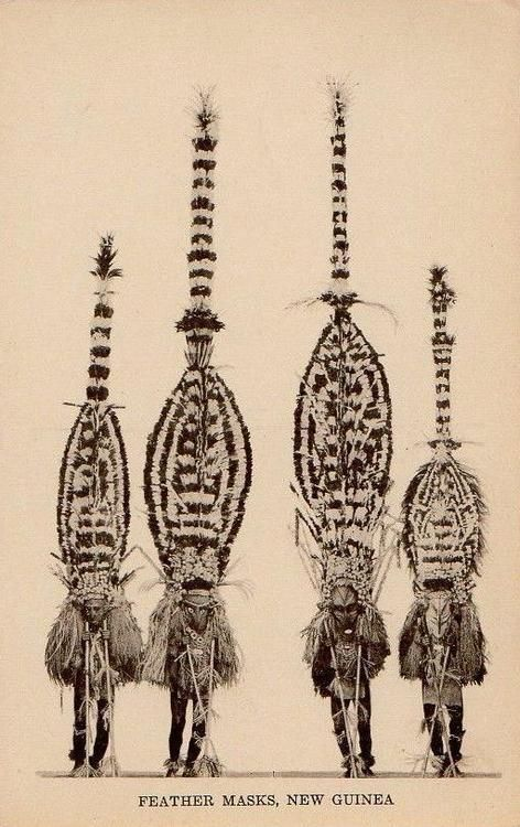 Feather masks, New Guinea. Postcard, Australia.