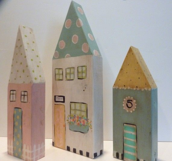 Adorable painted wooden houses in cheery pastels.