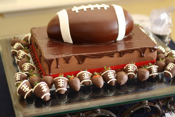 Football Groom's Cake with chocolate strawberries--Clanton, Alabama Cakery www.indulgesweetshoppe.com