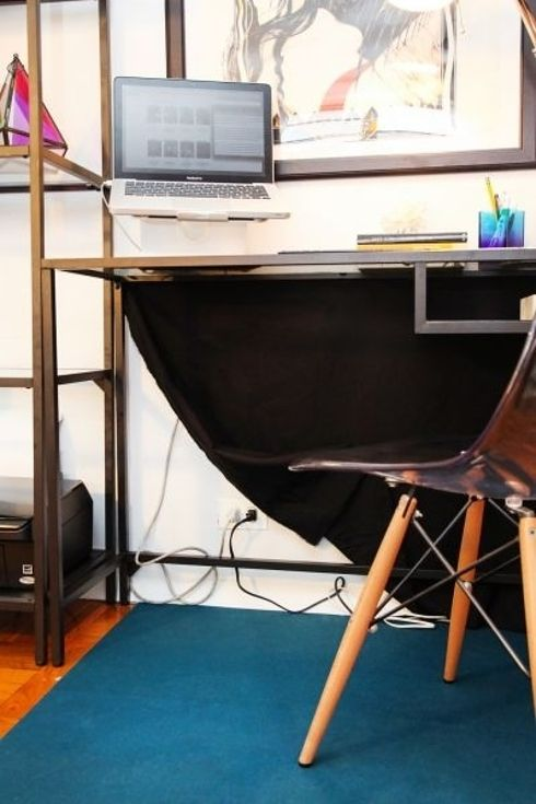 36 Genius Ways To Hide The Eyesores In Your Home: Use a drop cloth to hide wires behind a desk