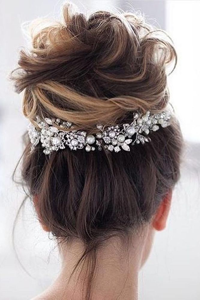 wedding hairstyles for medium hair updo messy volume high bun on dark hair with a silver accessory allbridals via instagram